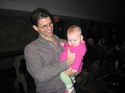 Dr Russel Goldman, Sasha's doctor on the palliative care team, holds Sasha's sister Mia Ruby